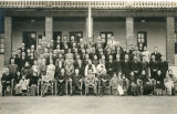Group portrait of employees and families at a customs building