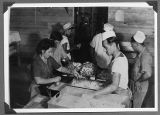 Internees preparing food